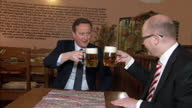 Interior shots David Cameron British Prime Minister sitting with Bohuslav Sobotka Czech Prime Minister drinking Czech Pilsner beer on January 22 2016...