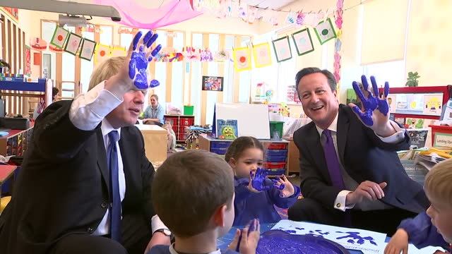 Interior shots David Cameron Prime Minister and leader of Conservative Party and Boris Johnson Mayor of London join blue colour hand painting session...