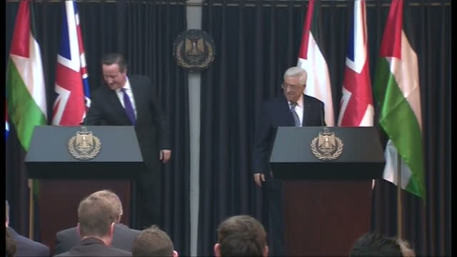 Interior shots David Cameron shaking hands with Mahmoud Abbas at end of presser on March 13 2014 in London England