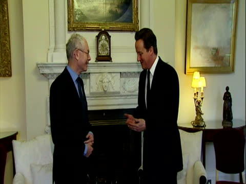 Interior shots David Cameron walks into No 10 Downing Street room with European Council President Herman Van Rompuy both pose for photo call before...