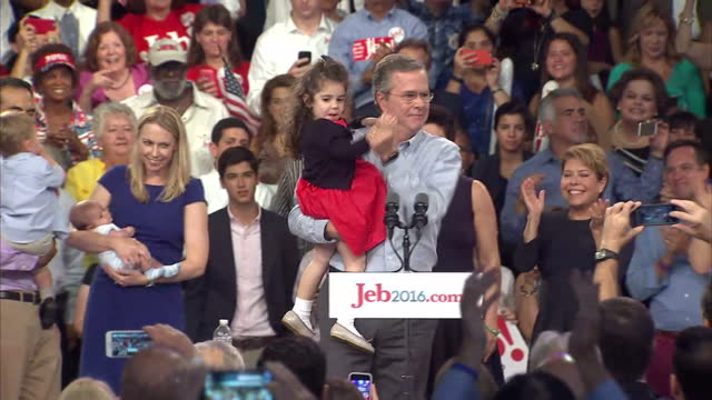 Interior shots end of Jeb Bush speech 'I'm asking for your vote' then joined by family on stage Noelle Bush and daughter in law Amanda Bush holding...