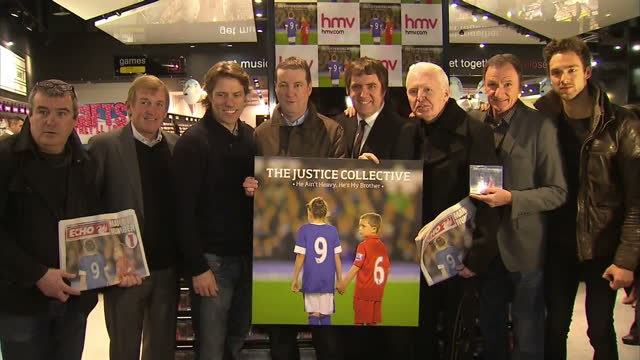 Interior shots former footballer Kenny Dalglish comedian John Bishop former footballer Phil Thompson pose for phot call holding The Justice...