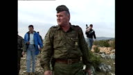 Interior shots General Ratko Mladic greets BosnianSerb soldiers whilst visiting countryside outpost on September 25 1992 in Bosnia and Herzegovina