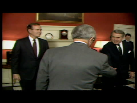 interior shots George Bush handshake with Margaret Thatcher Kenneth Baker photo op interior shots Thatcher gives George Bush a tour of 10 downing...