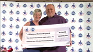 Interior shots Gillian Adrian Bayford pose for snappers with large cheque for £148 Million pounds Euro Millions Winners Pose For the Press on August...