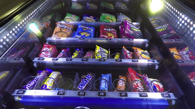 Interior shots GOPRO of vending machine dispensing crisps and sweets on November 16 2017 in London England