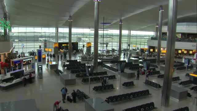 Interior shots Heathrow Terminal 2 departures lounge with passengers walking around airport on June 04 2014 in London United Kingdom