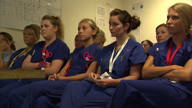 Interior shots hospital nurses sitting listening to briefing before shift 24 Hours in A E on September 07 2013 in Nottingham England