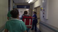 Interior shots hospital staff walking through hospital behind patient on stretcher 24 Hours in A E on September 07 2013 in Nottingham England