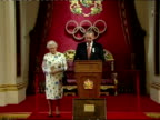 Interior shots IOC President Jacques Rogge announces from podium his gifts of Gold Silver Bronze medals to her Majesty the Queen Interior shots the...