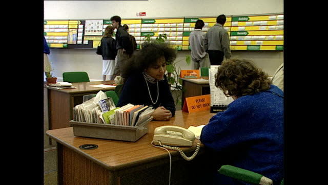 Interior shots job seekers sitting at desk talking with job centre staff members on February 16 1989 in Hounslow United Kingdom