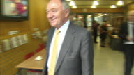 Interior shots ken Livingstone London Mayoral Candidate walks through building out into the street Exterior shots Ken Livingstone shakes hands with a...