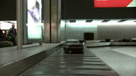 Interior shots luggage suitcase going round Baggage Carousel at Heathrow Airport on February 21 2015 in London England