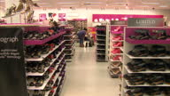 Interior shots Marks Spencer women's clothes ection with customers looking at various products Interior shots customers looking at shoes Marks...