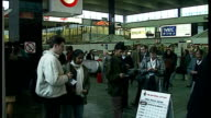 Interior shots National Lottery stall set up in Euston Station public queues up to buy tickets on November 8 1994 in London England