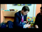 interior shots Nick Clegg holds baby girl in his arms speaks to parents at nursery The Liberal Democrats don't publish their manifesto until...