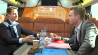Interior shots Nick Clegg Liberal Democrat leader sitting on election bus discussing campaign strategy with members of his team on March 31 2015 in...