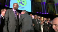 Interior shots Nigel Farage UKIP leader walks into room and greets people on stage at event designed to highlight's UKIP female black and ethnic...