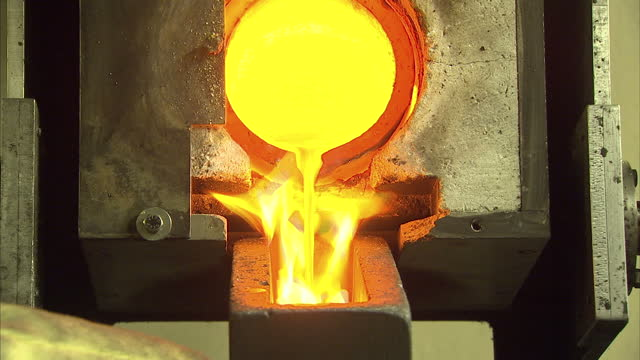 Interior shots of a goldsmith pouring molten gold from a smelting pot into a mold on August 24 2015 in London England