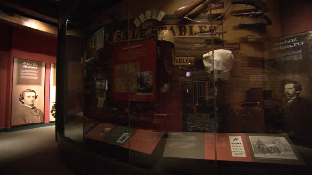 Interior shots of a historical display inside Ford's Theatre in Washington DC featuring paintings photographs etc of John Wilkes Booth and Abraham...