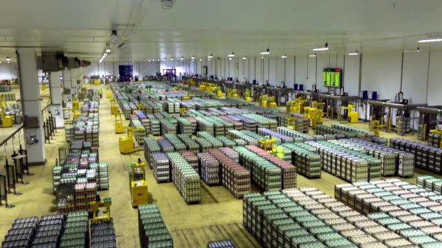 Interior shots of a large warehouse at a milk factory