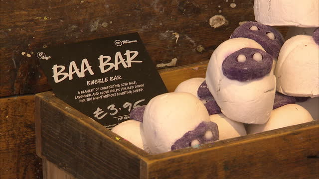 Interior shots of a Lush cosmetics shop with customers buying bath bombs at the checkout in support of the release of the British man held on death...