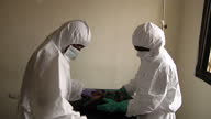 Interior shots of a nursing assistant in a Kono Ebola ward attending to a newborn baby born to an Ebola patient on January 12 2015 in Koidu Town...