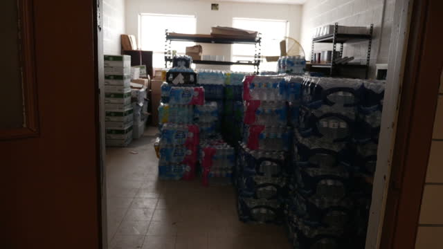 Interior shots of a store room piled high with bottled water at a Flint elementary school due to the local water supply being polluted on January 22...