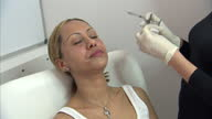 Interior shots of a woman receiving a botox injection> on April 24 2013 in London England