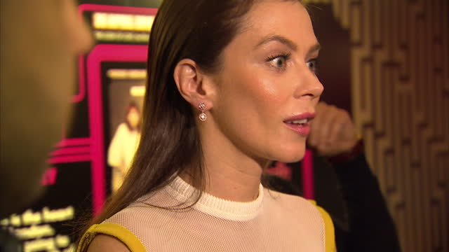 Interior shots of actress Anna Friel being interviewed at premiere of Look of Love wearing Trager Delaney yellow dress
