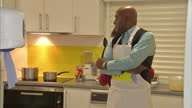 Interior shots of Ainsley Harriott preparing healthy meals in a school kitchen with dinner ladies as party of the government's 'Change 4 Life'...