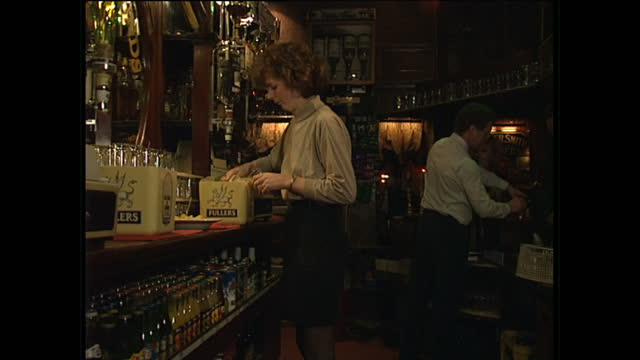 Interior shots of alcoholic and soft drinks on display shelves behind a bar including Tennents LA Holsten Pils Britvic bottled juices diet Pepsi and...