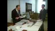 Interior shots of Alija Izetbegovic talking to people in Presidency building office in June 1992 in Sarajevo Bosnia and Herzegovina