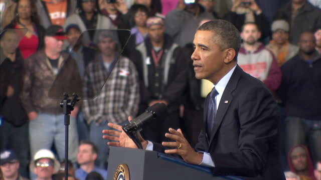 Interior shots of an audience listening cheering to President Barack Obama speaking at Newport News Shipbuilding Barack Obama gives speech to...