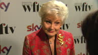 Interior shots of Angela Rippon giving an interview on the red carpet at Women In Film TV Awards at London Hilton on December 06 2013 in London...