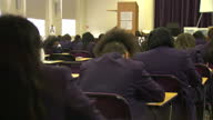 Interior shots of anonymous female GCSE pupils writing on test papers in a GCSE exam on June 04 2014 in Manchester England