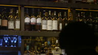 Interior shots of anonymous men women tasting whiskey at a whiskey bar on January 28 2011 in Beijing China
