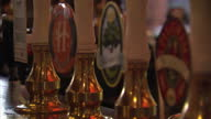 Interior shots of anonymous people drinking in pub interior shots of alcohol taps pilgrim Progress and New Forest Ale labels pub shots people...