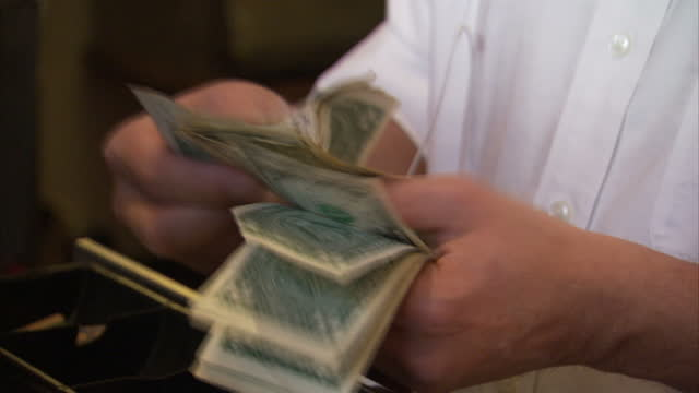 Interior shots of anonymous person counting US dollar bills on December 16 2015 in Washington DC
