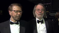 Interior shots of Benny Andersson Bjorn Ulvaeus of ABBA in the press room after performing at the Laurennce Olivier Awards on April 13 2014 in London...