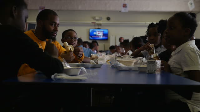 Interior shots of black elementary school pupils eating lunches in the school canteen and walking in a school corridor on January 22 2016 in Flint...