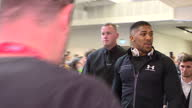 Interior shots of boxer Anthony Joshua walking through Sky HQ before holding a news conference with Wladimir Kitschko ahead of their world...