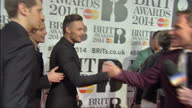 Interior shots of boyband One Direction arriving at the 2014 BRIT Awards and greeting reporters briefly>> on February 19 2014 in London England