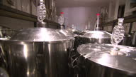 Interior shots of brewers working in a microbrewery using various brewing equipment on July 20 2016 in London England