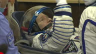 Interior shots of British cosmonaut Tim Peake having his pressurised suit checked by technicians whilst his family watches at Baikonur Cosmodrome on...