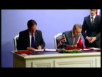 Interior shots of British Prime Minister David Cameron and Turkish Prime Minister Recep Tayyip Erdogan signing a 'strategic partnership' that will...