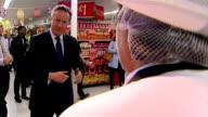 Interior shots of British Prime Minister David Cameron walking round an Asda Supermarket speaking to staff on April 07 2014 in Battersea England