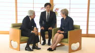Interior shots of British Prime Minister Theresa May meeting Japanese Emperor Akihito who bow and shake hands before sitting down for talks on 1st...
