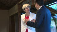Interior shots of British Prime Minister Theresa May with Japanese Prime Minister Shinzo Abe entering room with shoes off and taking seats on 30th...