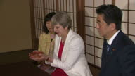 Interior shots of British Prime Minister Theresa May with Japanese Prime Minister Shinzo Abe sitting and trying ceremonial tea on 30th August 2017